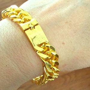 Unisex Gold tone bracelet